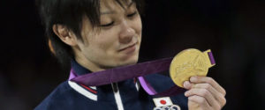 Japanese gymnast Kohei Uchimura holds his gold medal during the medal ceremony of the Artistic Gymnastic men's individual all-around competition at the 2012 Summer Olympics, Wednesday, Aug. 1, 2012, in London. (AP Photo/Julie Jacobson)